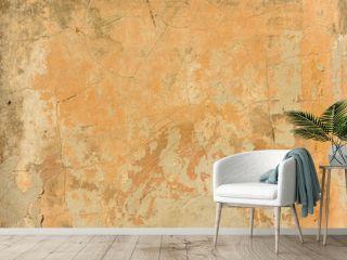 texture of old peeling yellow plaster