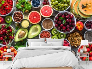 Selection of healthy food. Superfoods, various fruits and assorted berries, nuts and seeds.
