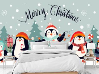 Christmas card design with cute penguins on an winter landscape