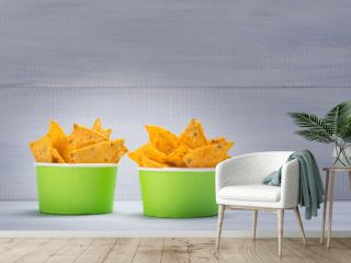 two buckets of chips-nachos, on a gray background, with space for writing