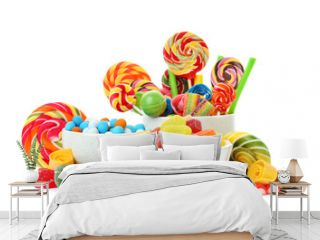 Composition with many different yummy candies on white background