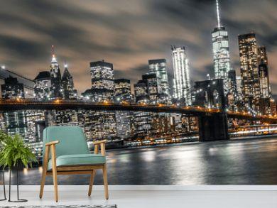 brooklyn bridge night long exposure with a view of lower manhattan