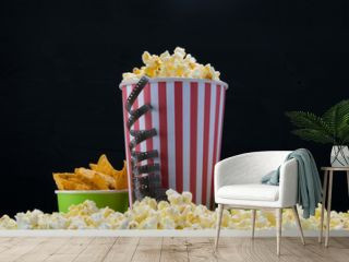 cinema snack, popcorn and two buckets of nachos on a black background
