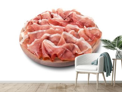 Round chopping board with sliced Parma ham