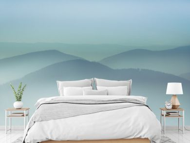Misty mountain hills landscape. View of  layers of mountains and haze in the valleys. The effect of color tinting.
