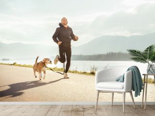 Morning jogging with pet: man runs together with his beagle dog