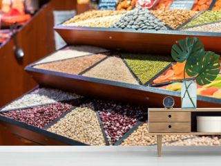 counter with rows of different grains in the market store f