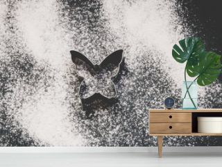The silhouette of the butterfly painted with white flour on a dark background.Toned