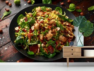 Roasted brussel sprouts, bacon warm salad with spinach, croutons and hazelnuts