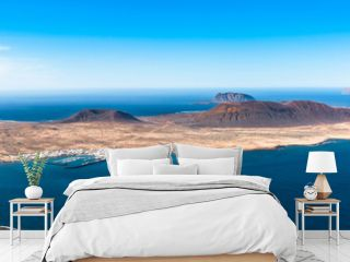 Unique panoramic magnificent aerial view of volcanic islands La Graciosa, Montana Clara, Allegranza in Atlantic ocean, from Mirador del Rio, Lanzarote, Canary Islands, Spain. Travel concept.