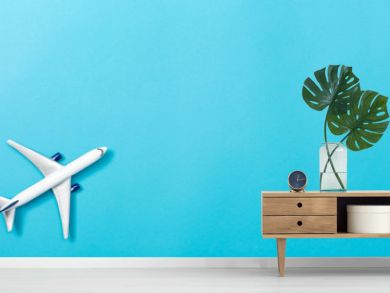 A toy airplane on a blue paper background