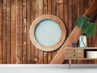 Wooden pirate ship cabin round frame glass window.