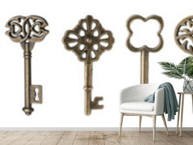 Set of bronze vintage ornate keys on white background