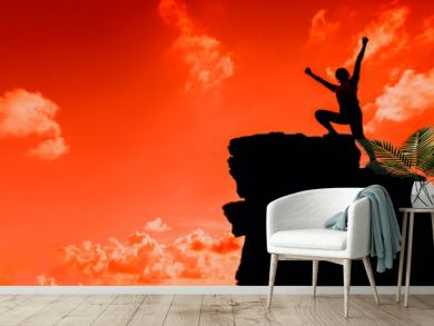 Silhouette Sporty woman climbing on the cliff. Success and goal concept. Strong and healthy for outdoor activity.