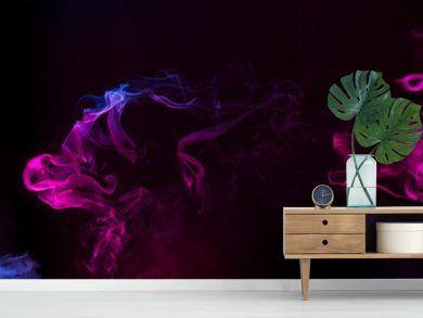 blue and purple swirls of smoke on black background