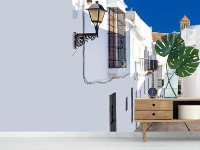 Horizontal cropped image narrow street of Vejer de la Frontera spanish picturesque village, popular hilltop town municipality in province of Cadiz, Costa de la Luz, Spain