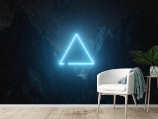 Beautiful minimalistic fantastic landscape. Bright blue neon triangle among the mountains against the background of a rotating night starry sky. 3d illustration