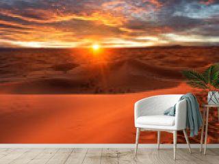 Amazing sunset over the dunes Erg Chebbi in the Sahara desert near Merzouga, Morocco , Africa. Beautiful sand landscape with stunning sky