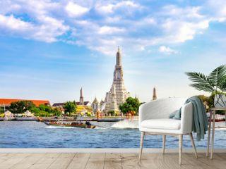Wat Arun Temple with long tail boat in Bangkok Thailand.