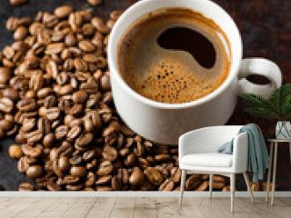 white espresso coffee Cup and roasted beans on old rusty brown background