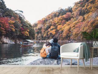 Young couple traveler looking beautiful landscape at arashiyama Japan, Travel lifestyle concept