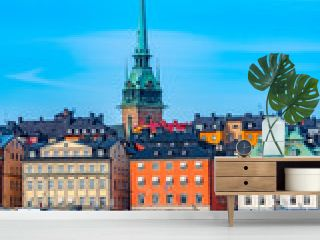 German church and colourful buildings of Gamla Stan in Stockholm viewed across the water, Sweden.