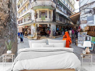 corner street scene in the city of stone town zanzibar town full of life and activity