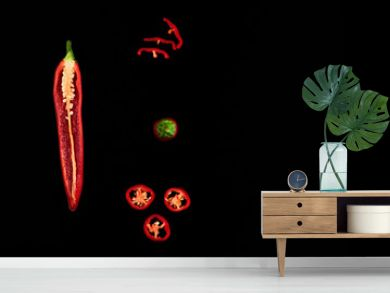 Seamless pattern with red hot chili peppers. Vegetables abstract background. Food collage, slicing hot red chili peppers Red hot chili peppers on a black background.