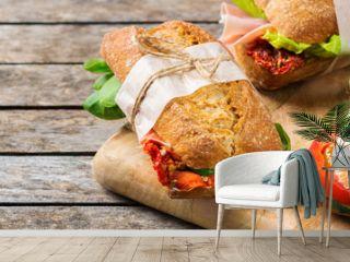 Fresh bread sandwich with ham, lettuce and tomato