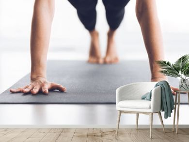 Slim woman practicing yoga in Plank pose, closeup