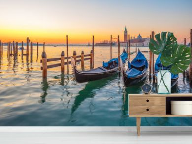 Sunrise at Venice with gondola and island of st george view from the square San marco