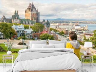 Canada travel Quebec city tourist enjoying view of Chateau Frontenac castle and St. Lawrence river in background. Autumn traveling holiday people lifestyle.
