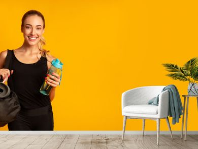 Woman Holding Fitness Bag Ready For Training, Studio Shot, Panorama