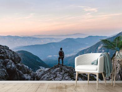 Breathtaking Views From Mangart Peak at Stunning Sunrise. Peaks Above Clouds.