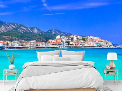 Most beautiful traditional villages of Greece - Kokkari in Samos island. crystal sea and taverns