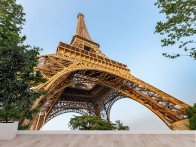 Eiffel tower against blue sky. Wide angle shot from below. Paris, France.