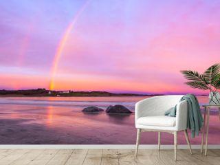 rainbow over beach at farstad in norway