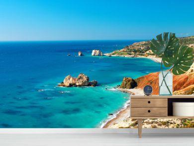 Seashore and pebble beach with wild coastline in Cyprus island, Greece by Petra tou Romiou sea rocks
