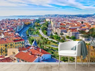 Nice, France - December 1, 2019: Colorful aerial panoramic view over the old town, with the famous Massena square and the Promenade du Paillon, from the roof of Saint Francis tower
