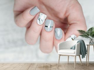 white grey marble manicure with silver stripe on grey background