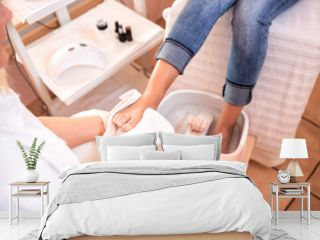 Pedicure for feet, foot in a towel after spa pedicure treatment, drying of a foot with towel