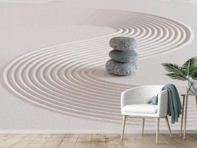 Japanese zen garden with stone in textured white sand