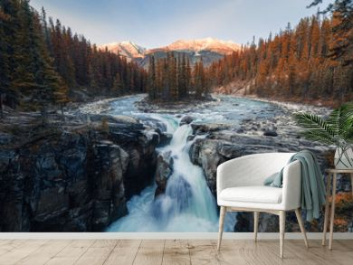 Sunwapta Falls is pair of the Sunwapta river in autumn forest at sunset. Icefields Parkway, Jasper national park
