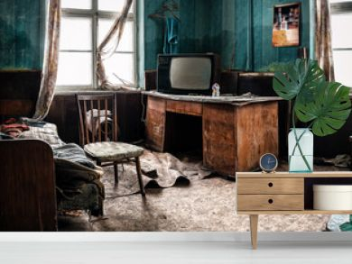 old tv and different garbage in abandoned room