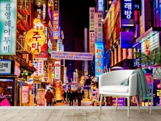 Illuminated Buildings And City Street At Night