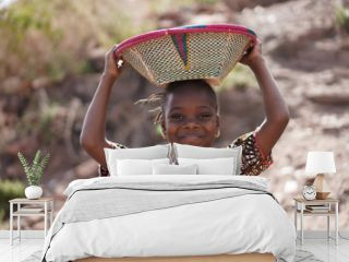 Gorgeous African Girl with Toothy Smile and Basket on Head