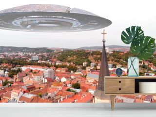 Alien ufo flying Saucers over Large City in Europe, Aerial Red rooftops city in europe with large church cross