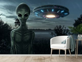 Green alien with black large glass eyes on the background of a flying saucer. UFO concept, aliens, contact with extraterrestrial civilization