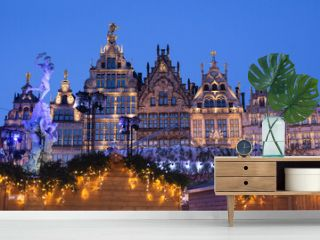 Traditional Christmas market in Europe, Antwerp, Belgium. Main town square with decorated tree and lights - Christmas fair concept.