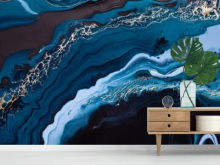 Acrylic Fluid Art. Blue colors waves in abstract ocean of blue paint and golden swirls. Marble effect background or texture